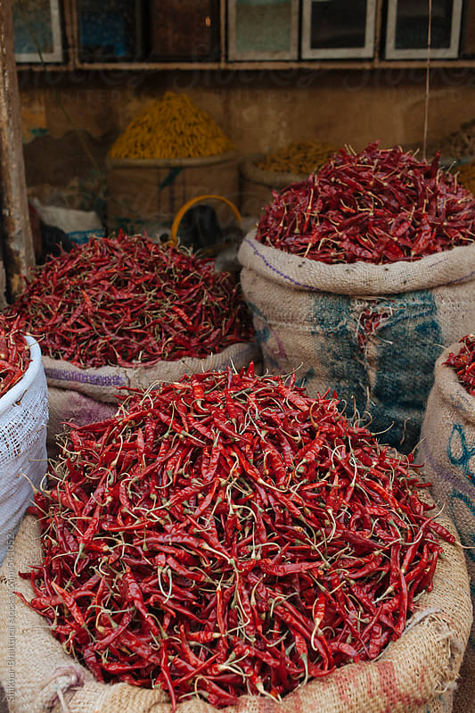 Spices for sale in a bazar in South Asia. by Shikhar Bhattarai for Stocksy United
