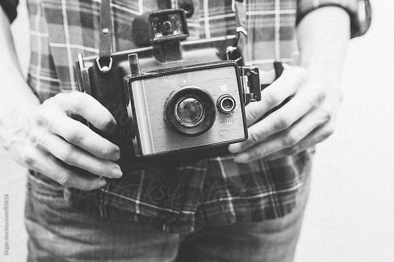 Woman holding vintage instant camera by kkgas for Stocksy United