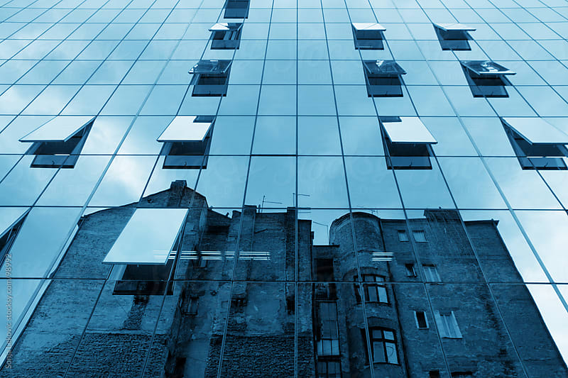 reflection of the old building in the new one by Sonja Lekovic for Stocksy United