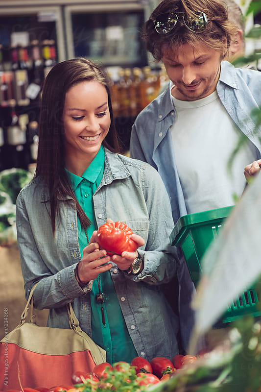 Couple shopping at fresh foods Market by Aila Images for Stocksy United