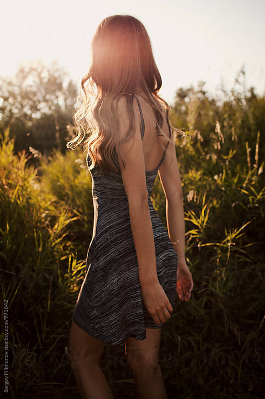 Back view of a girl at sunset by Sergey Filimonov for Stocksy United