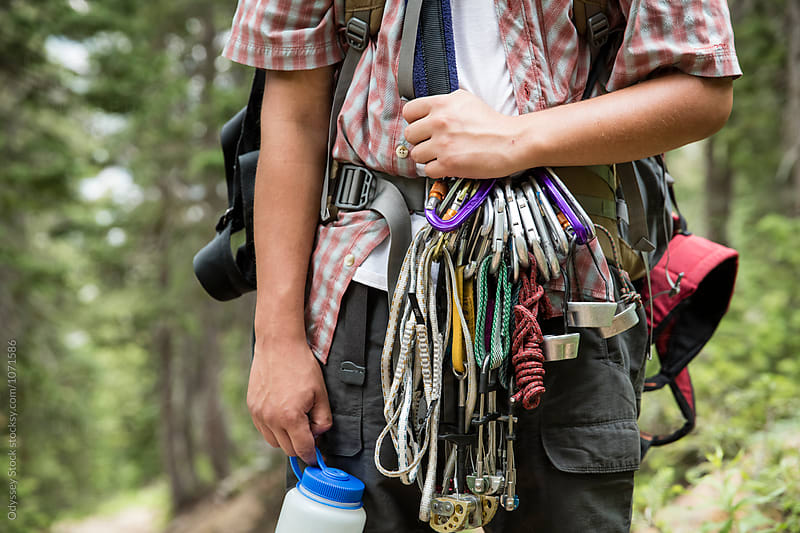 Young Man Carrying Mountaineering Equipment by Odyssey Stock for Stocksy United