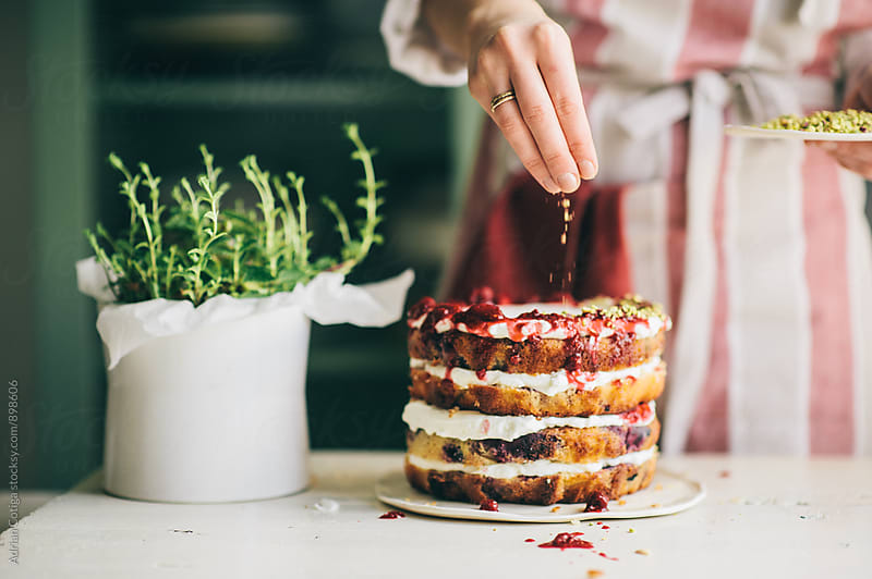 Decorating delicious naked cake by Adrian Cotiga for Stocksy United