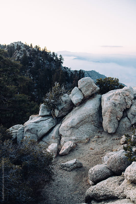 Boulders At Top Of Mountain Peak Overlooking Valley by Luke Mattson for Stocksy United