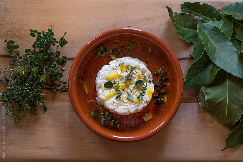 Homemade Ricotta Cheese Marinated with fresh herbs and Lemon Oli by Rowena Naylor for Stocksy United