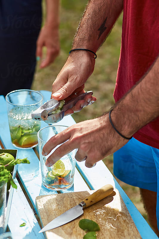 Close-up of mojito preparation by Guille Faingold for Stocksy United