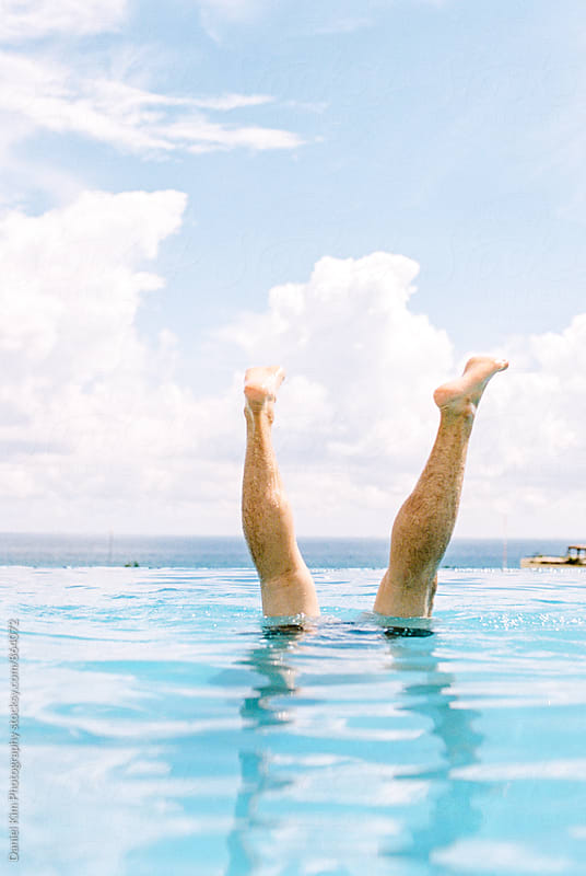 Handstand under water by Daniel Kim Photography for Stocksy United