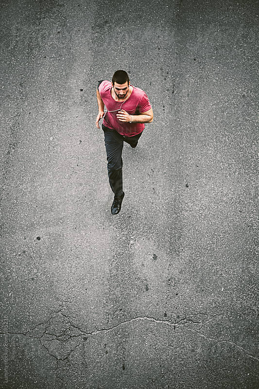 Man Running on the Street by Lumina for Stocksy United