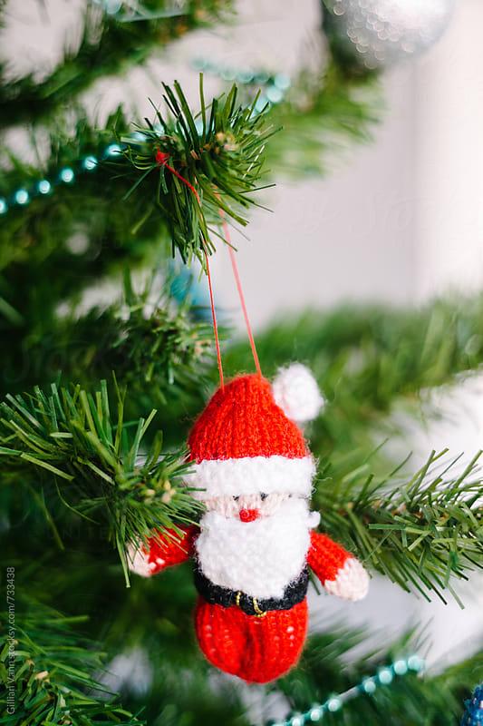 handmade knitted santa christmas ornament by Gillian Vann for Stocksy United