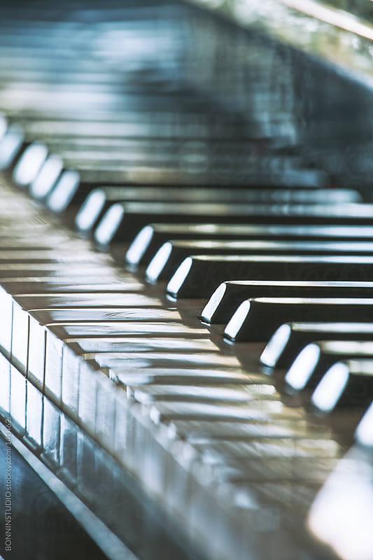 Closeup of piano keys. by BONNINSTUDIO for Stocksy United