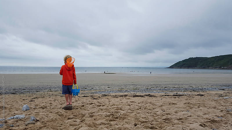 Child stood on the beach by sally anscombe for Stocksy United