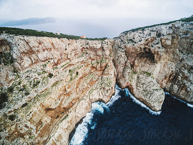 Aerial view of a cliff over the sea by Luca Pierro for Stocksy United