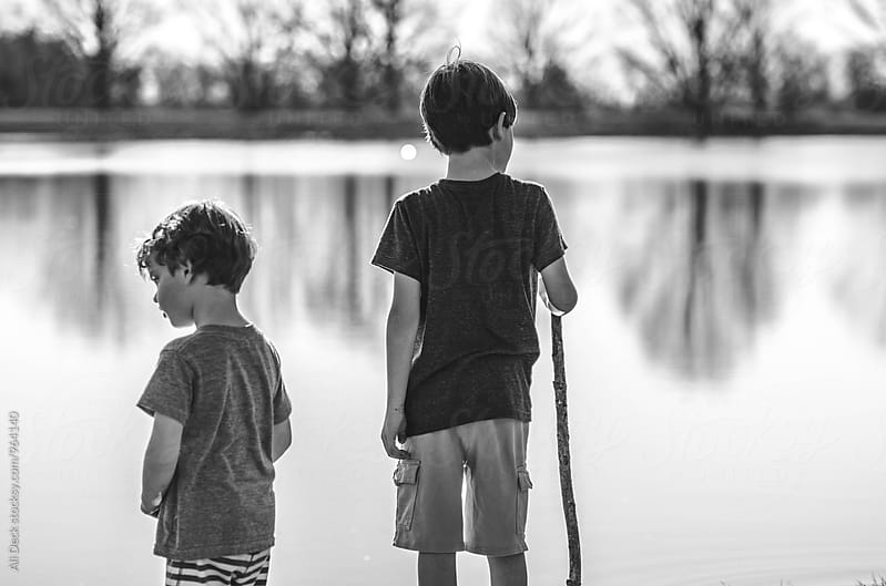 Boys by a Lake by Ali Deck for Stocksy United
