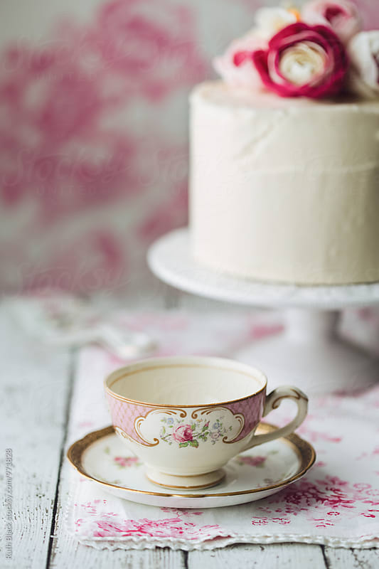 Vintage teacup with cake by Ruth Black for Stocksy United