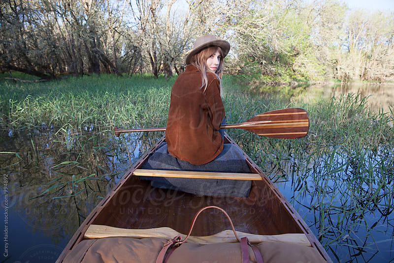 Woman In A Canoe by Carey Haider for Stocksy United