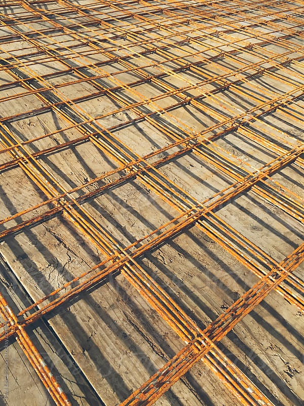 Detail of metal framing on construction site by Paul Edmondson for Stocksy United