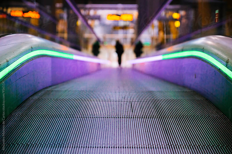 Illuminated subway escalator by Alejandro Moreno de Carlos for Stocksy United