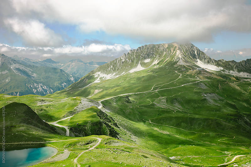 Beautiful Alps landscape of a mountains and lake. by BONNINSTUDIO for Stocksy United