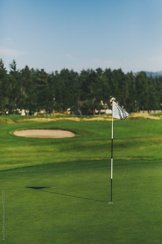Golf Green with Flag on Golf Course by Evan Dalen for Stocksy United