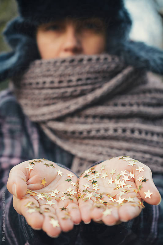 Woman holding glitter by Pixel Stories for Stocksy United