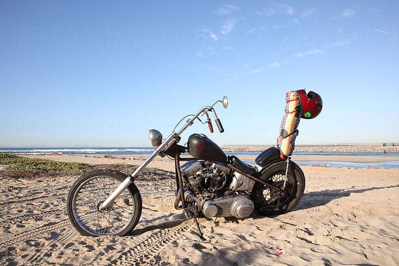 A Motorcycle Parked On The Beach by Carey Haider for Stocksy United
