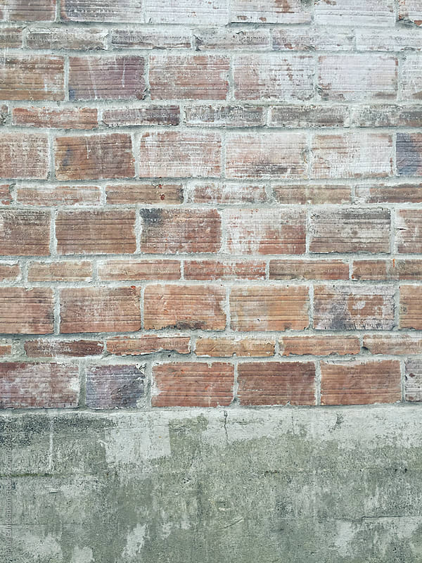 Detail of worn brick wall by Paul Edmondson for Stocksy United