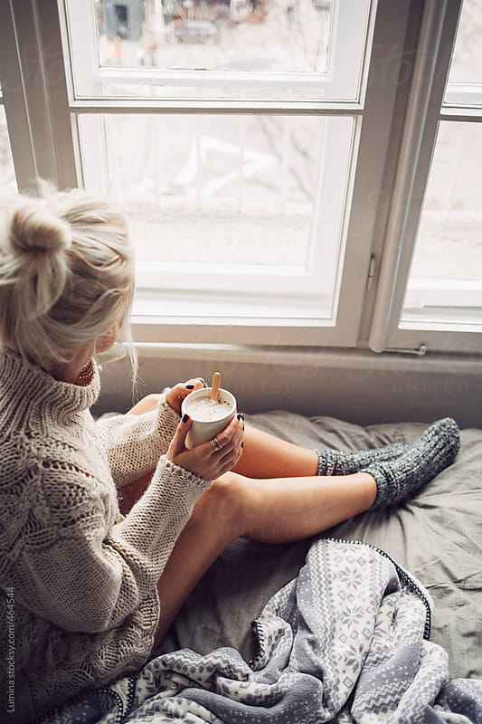Blonde Woman Drinking Morning Coffee in Bed  by Lumina for Stocksy United