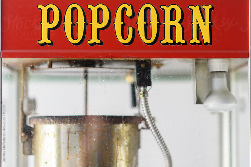 old-fashioned glass popcorn popper by Deirdre Malfatto for Stocksy United