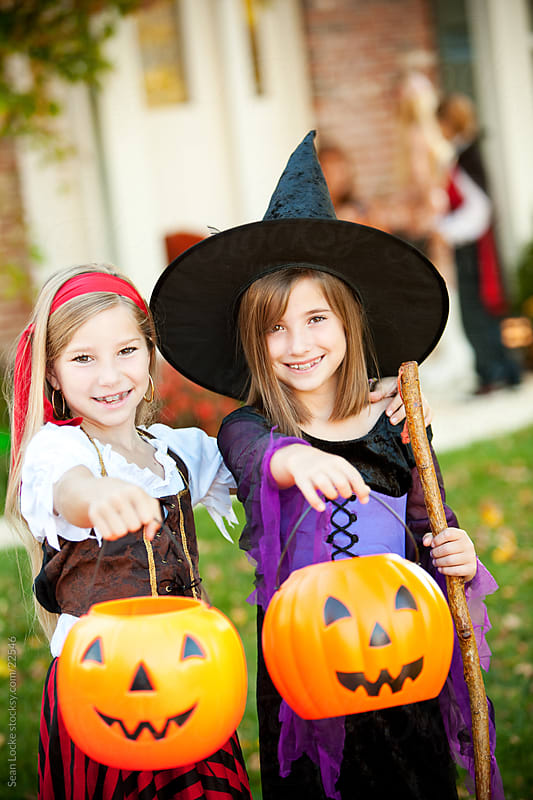 Halloween: Witch and Pirate Trick or Treating by Sean Locke for Stocksy United