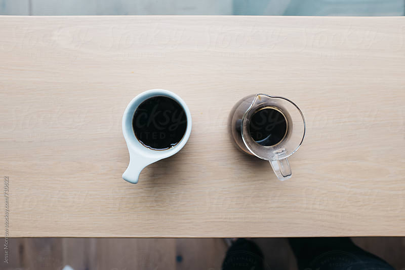 Morning coffee poured in modern cafe by Jesse Morrow for Stocksy United
