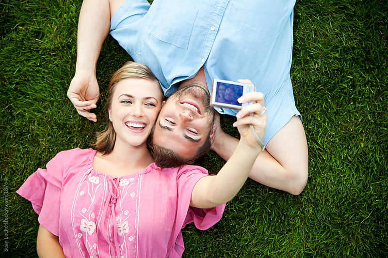 Grass: Cute Couple Taking a Self Portrait by Sean Locke for Stocksy United
