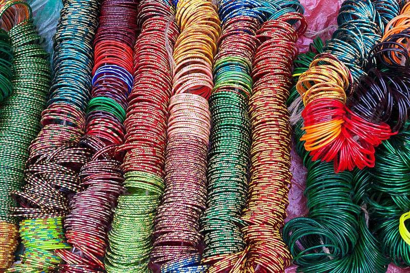 vibrant colorful bangles for sale at a bazaar in Asia. by Shikhar Bhattarai for Stocksy United