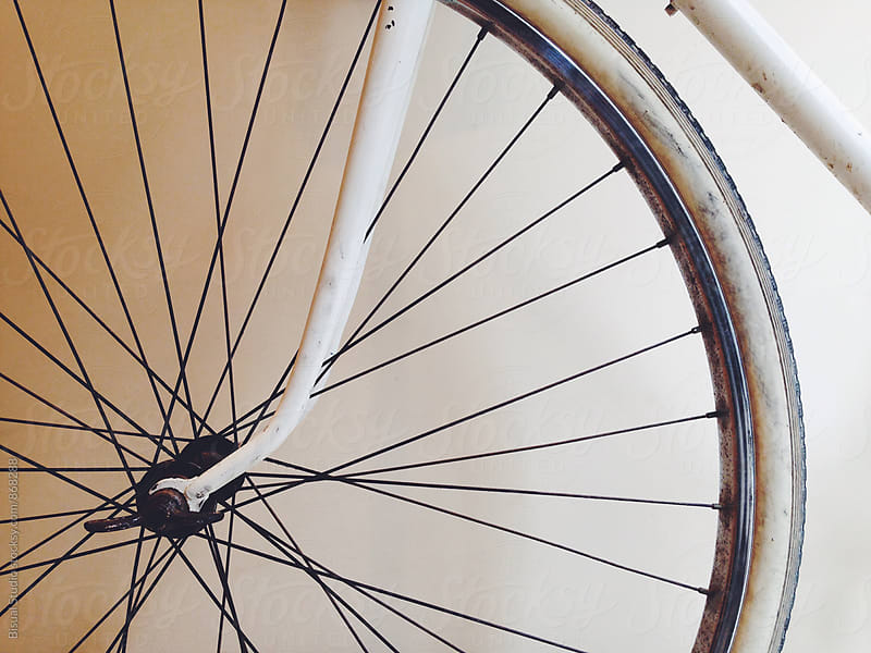 Closeup of a white vintage bicycle by Bisual Studio for Stocksy United