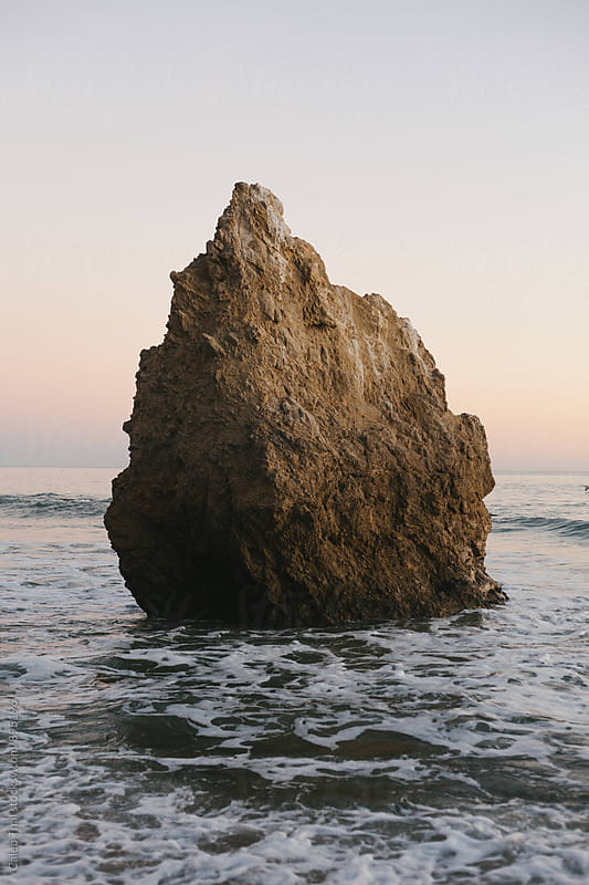Rock Formation in Ocean by Caleb Thal for Stocksy United