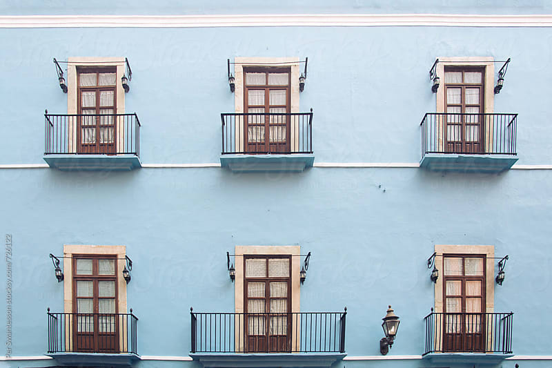 Old European style baby blue colonial building in Guanajuato, Mexico by Per Swantesson for Stocksy United