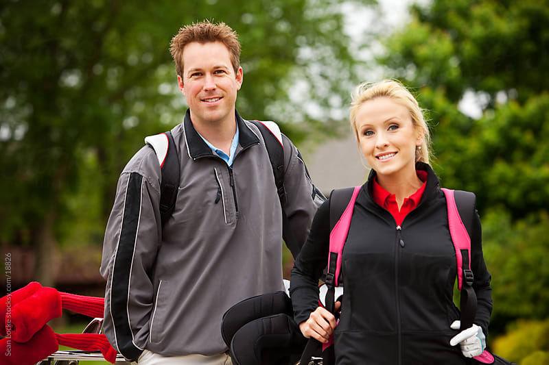 Golf: Couple Ready to Play Golf by Sean Locke for Stocksy United