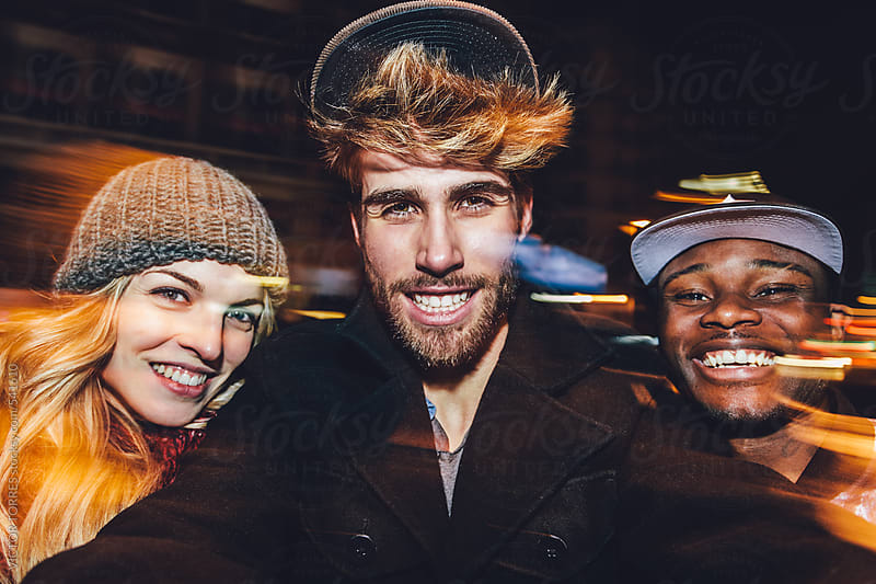 Three Multi-ethnic Friends Having Fun in the City at Night by VICTOR TORRES for Stocksy United