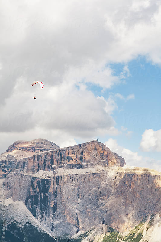 Paraglider Flying over the Rocky Dolomite Mountains by Giorgio Magini for Stocksy United