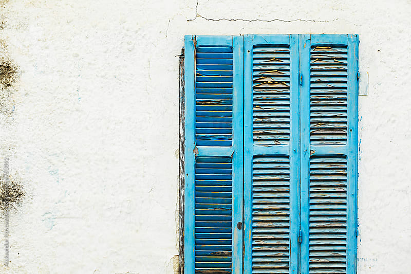 Detail shot of blue window of a greek house by Aleksandar Novoselski for Stocksy United