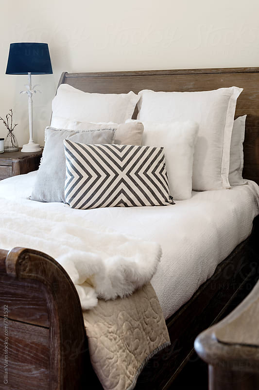 modern bedroom in neutral tones by Gillian Vann for Stocksy United