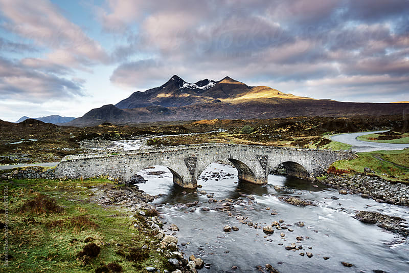 An old bridge crossing a river in Scotland by James Ross for Stocksy United