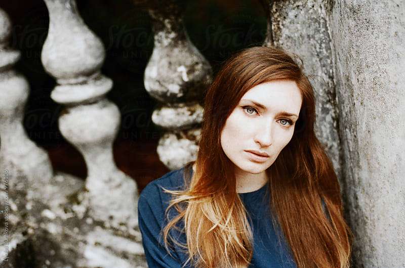 Portrait of young woman looking at camera by Lyuba Burakova for Stocksy United