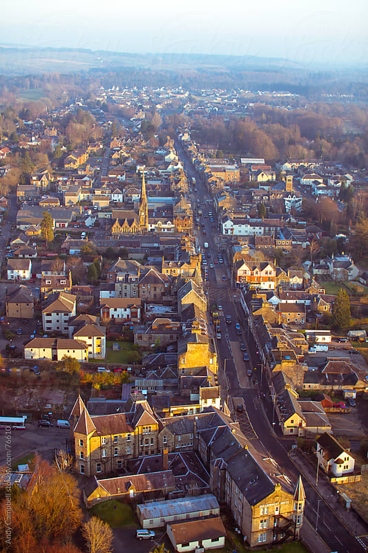 Aerial view of a Scottish village at sunset by Andy Campbell for Stocksy United
