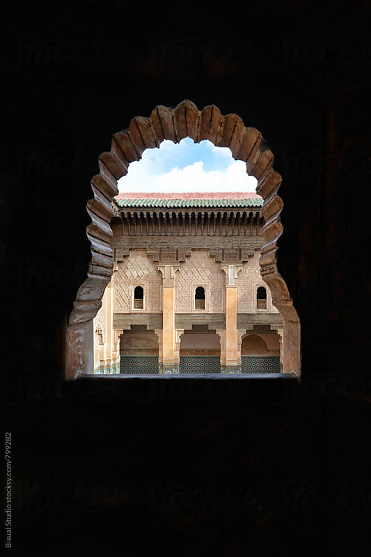 Views of Ben Youssef Madrasa in Marrakesh though a window  by Bisual Studio for Stocksy United