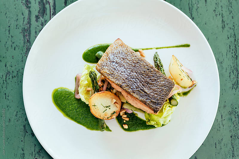 Fried salmon fillet with potatoes and asparagus by Lior + Lone for Stocksy United