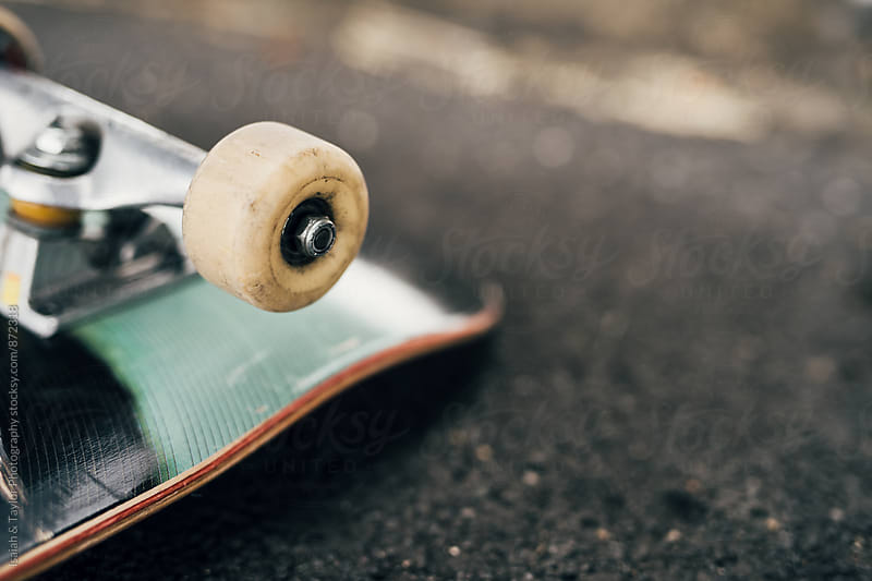 Skateboard on ground by Isaiah & Taylor Photography for Stocksy United