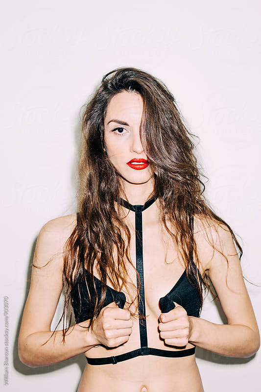 Edgy Lingerie Model in Direct Flash with Lipstick by William Blanton for Stocksy United