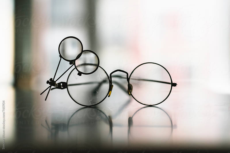 Glasses with magnifying glass by WAVE for Stocksy United