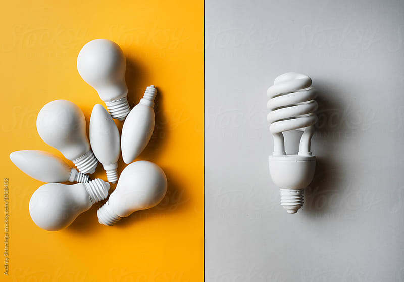 Classic and economic light bulbs against each other. by Audrey Shtecinjo for Stocksy United