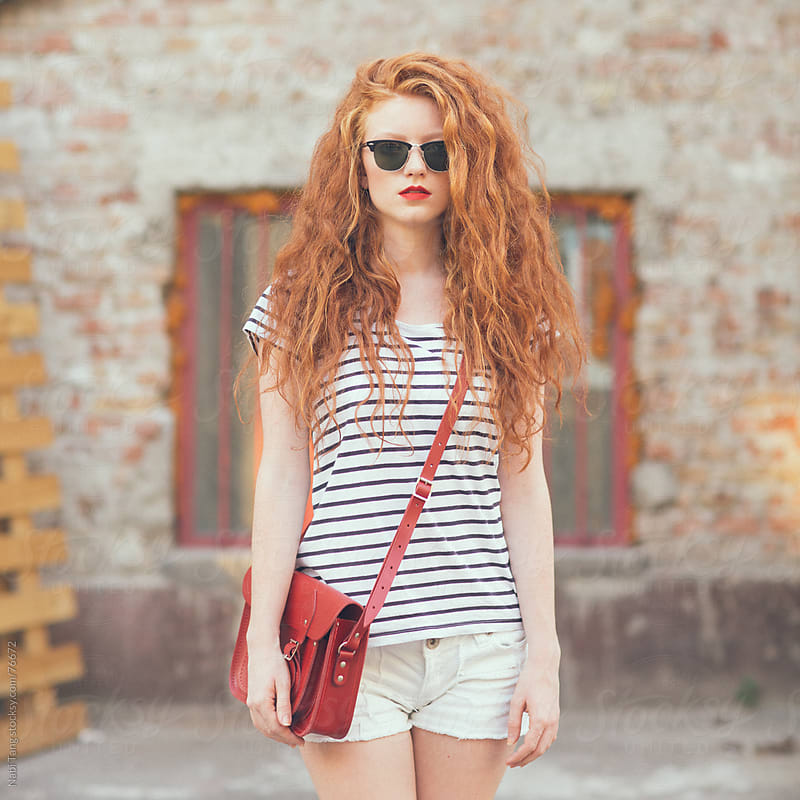 Teenage red hair girl outdoor portrait by Nabi Tang for Stocksy United